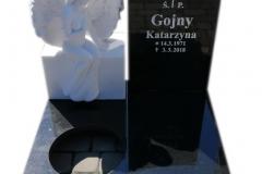 125 Nagrobek urnowy z czarnego granitu wraz z rzezba z bialego marmuru, Niemcy
