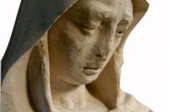 twarz Maryji w trakcie renowacji